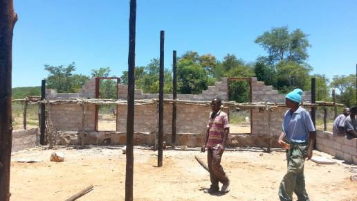 Gum poles for the roofing structure were cut down from a nearby farm and treated with creosote to prevent termite damage.